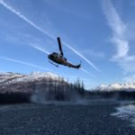 Helicopter Flying Over Mountains in Alaska